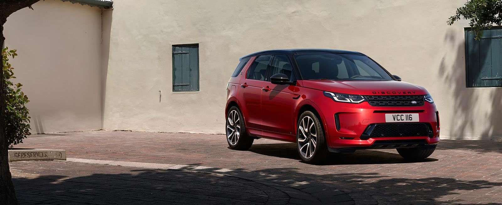 Red Discovery Sport Parked In Town