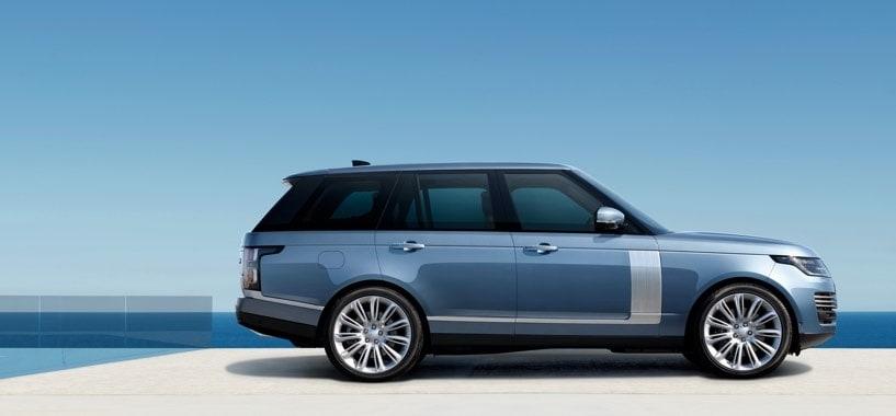 Blue Range Rover Overlooking the Ocean