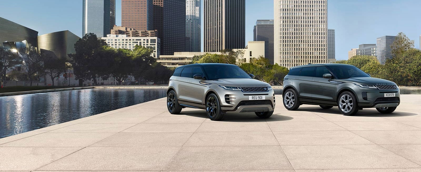 Bronze and Grey Range Rover Evoques Displayed Side By Side in a City