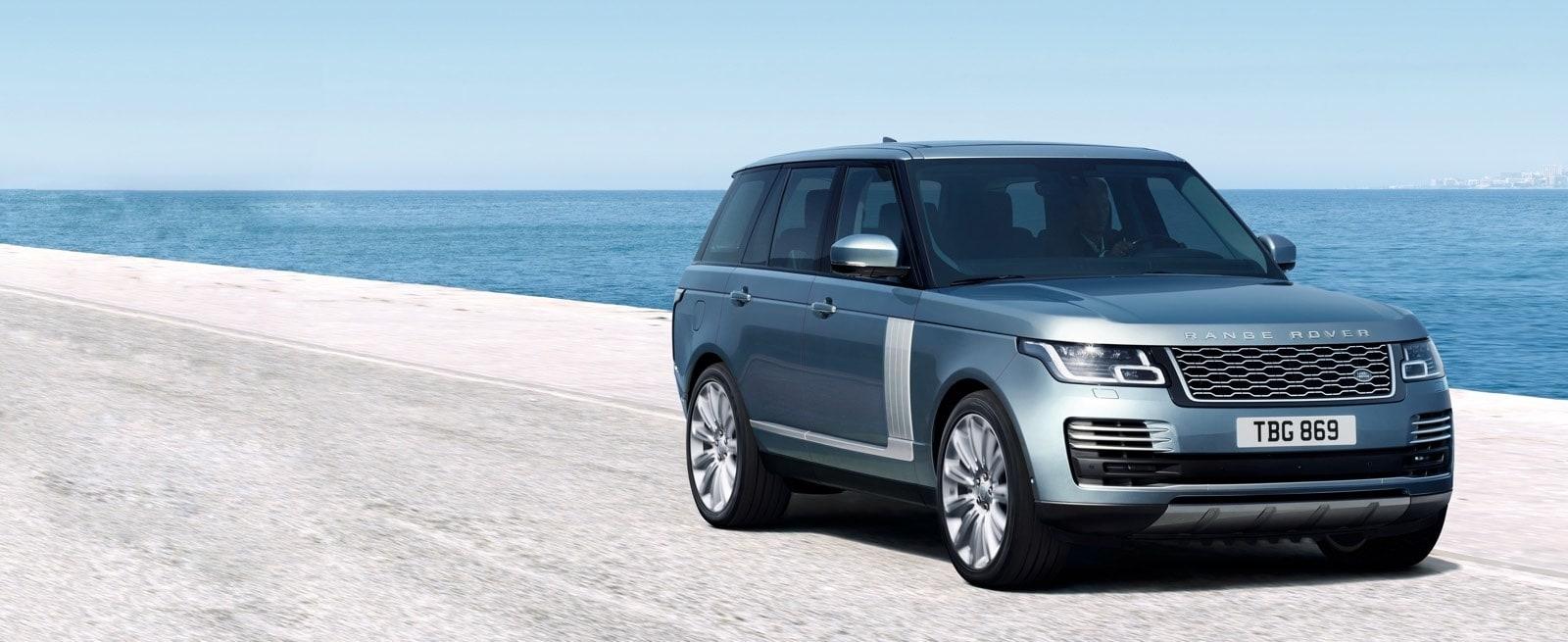 Blue Range Rover Driving along a beachfront