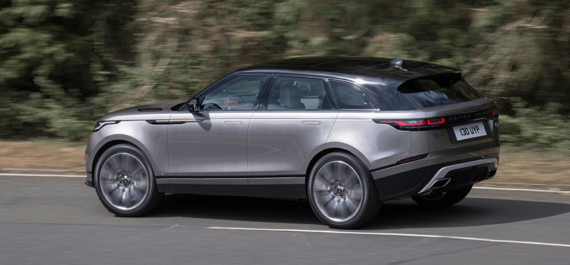 Silver Velar Driving Quickly
