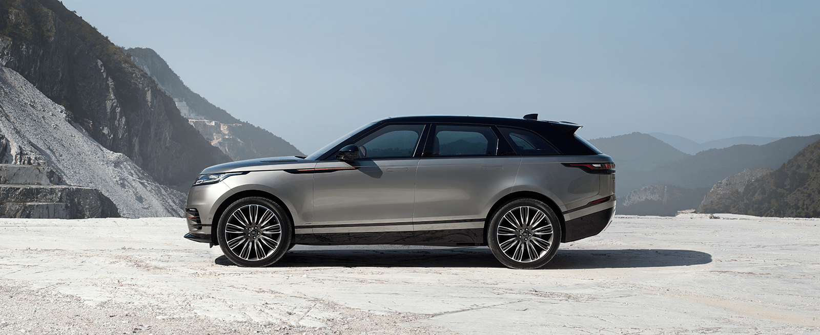 Silver Range Rover Velar Parked with A Backdrop of Mountains